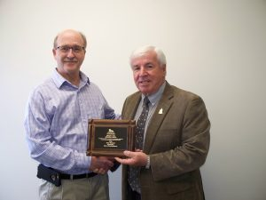 Councillor Terry Bernard, City of Charlottetown, accepts the Bruce H. Yeo Memorial Award from FPEIM President, Bruce MacDougall