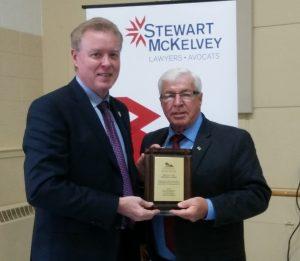 Bruce MacDougall presenting award to David Dunphy